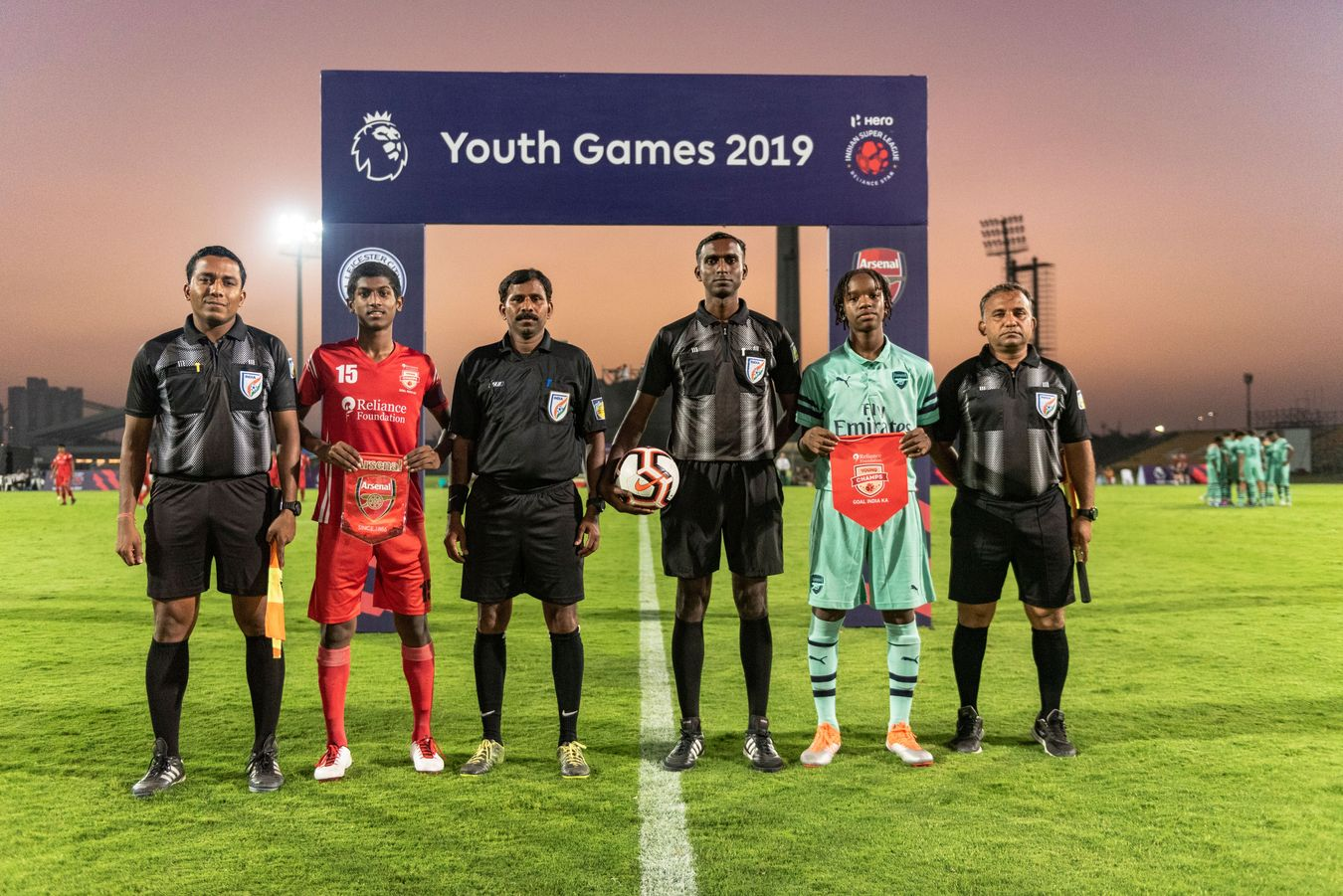 Match officials and captains of Reliance Young Champs and Arsenal at the 2019 Youth Games