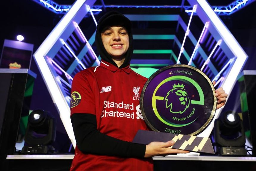 F2Tekkz celebrates with ePremier League trophy
