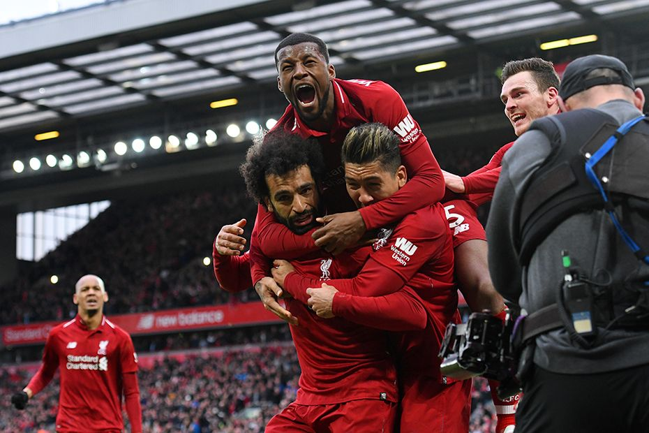 Liverpool players celebrate win over Spurs
