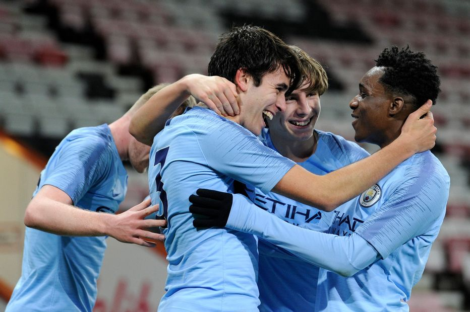 Man City's Jeremie Frimpong (right) and his team-mates
