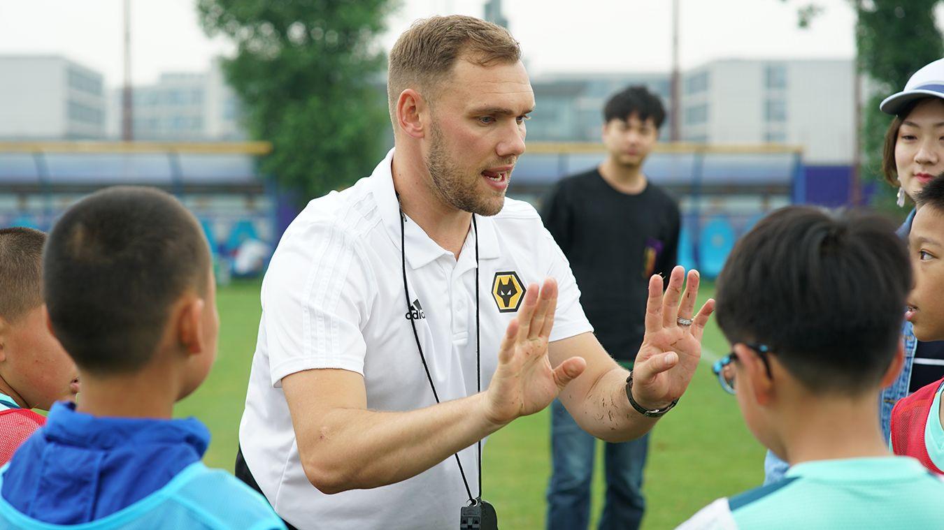 James McPike, coaching in China for Wolverhampton Wanderers