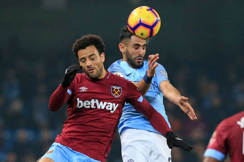Felipe Anderson and Riyad Mahrez compete in the air, Man City v West Ham