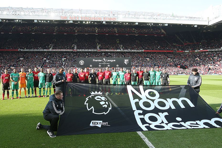 A No Room For Racism banner is displayed at Old Trafford