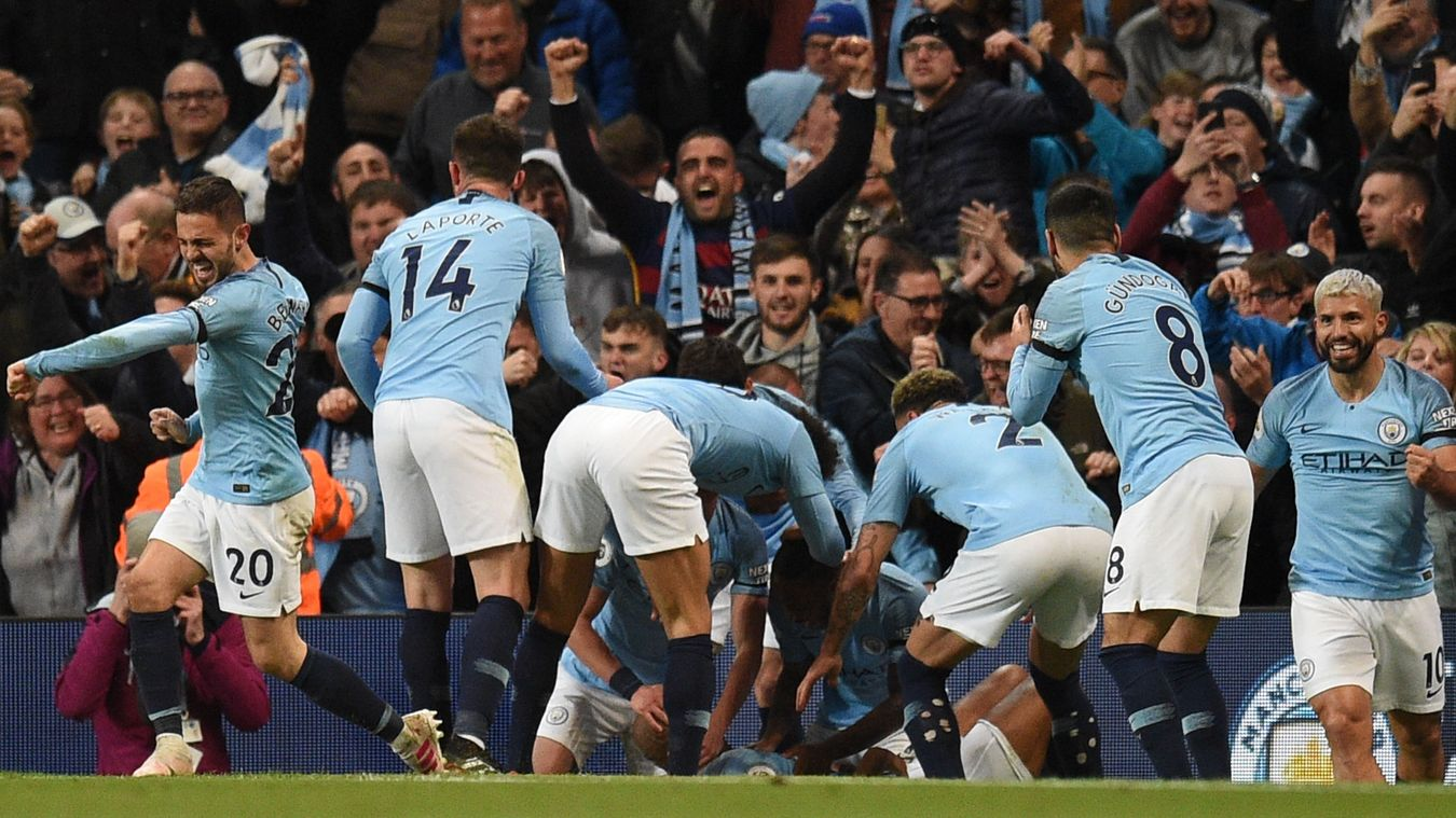 Vincent Kompany is mobbed by his team-mates after his late wonder strike