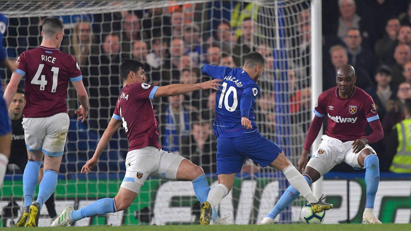 Eden Hazard jinks past Fabián Balbuena on his way to breaking the deadlock
