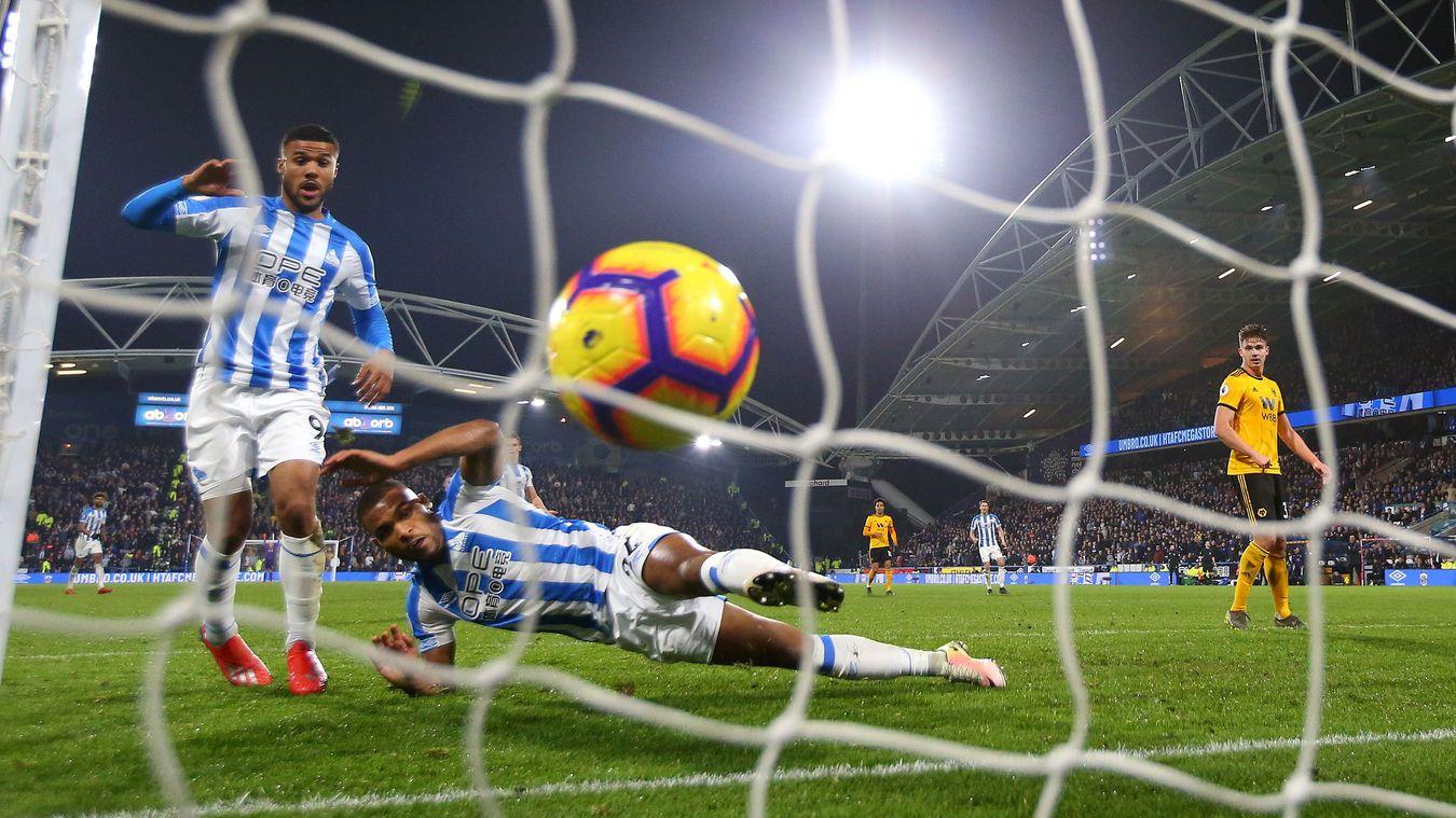Steve Mounie and Elias Kachunga look on as the ball crosses the line