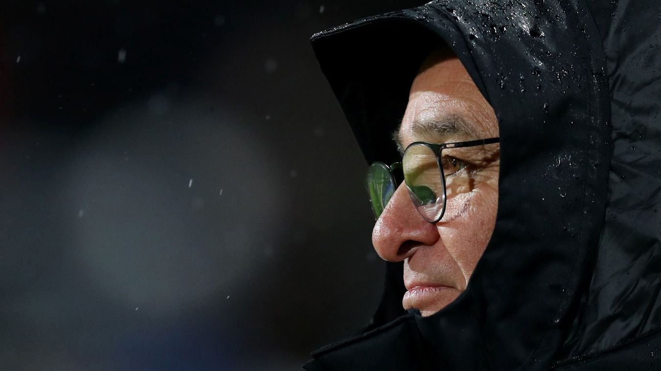 Claudio Ranieri looks on during a wet night at Craven Cottage