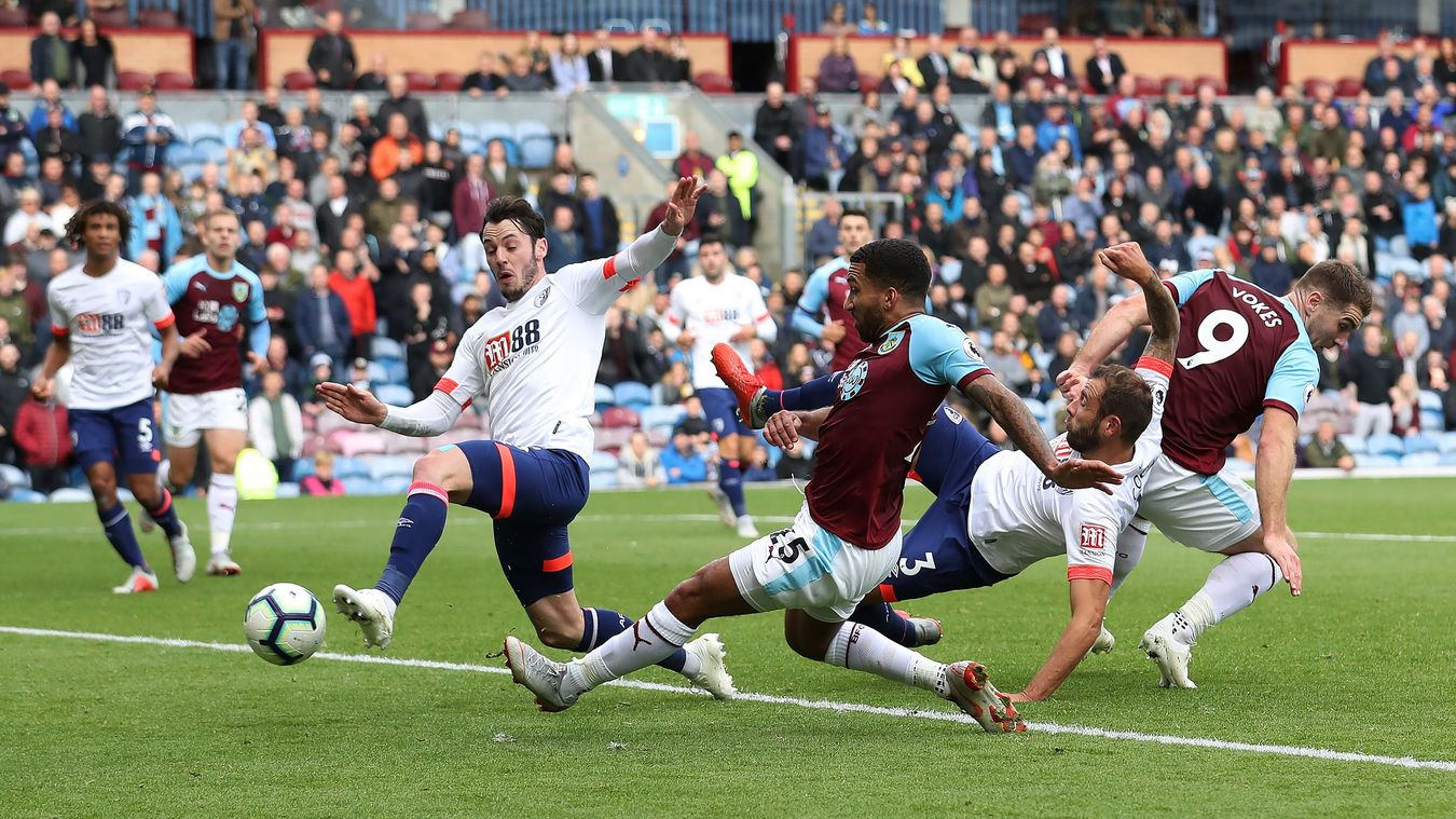 Aaron Lennon slides in to score his first goal for Burnley
