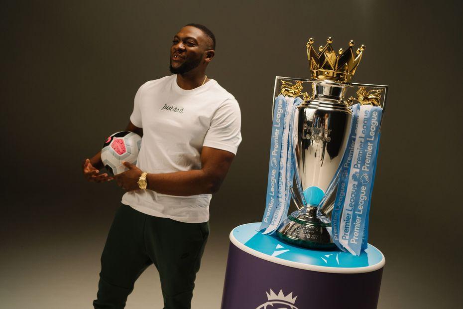 Rapman with the Premier League Trophy