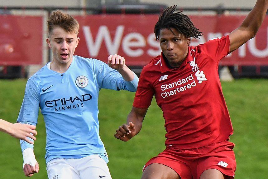 Man City's Ben Knight and Liverpool's Yasser Larouci