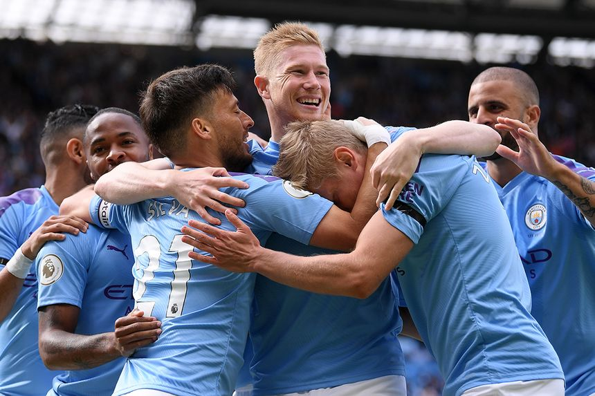 Kevin De Bruyne celebrates with his Man City team-mates