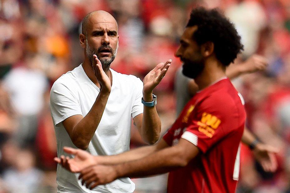 Pep Guardiola and Mohamed Salah