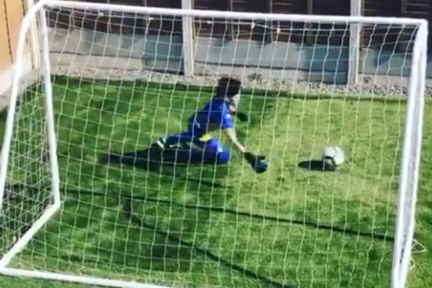 Leeds boy playing goalie by himself