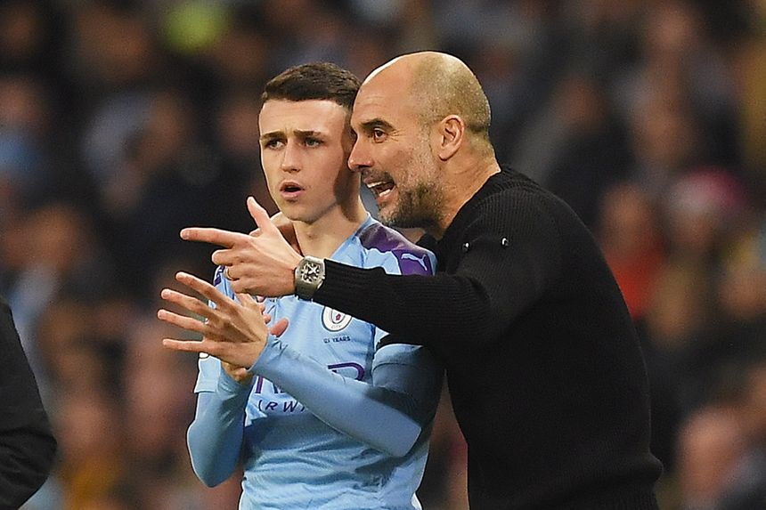 Man City midfielder Phil Foden and manager Pep Guardiola