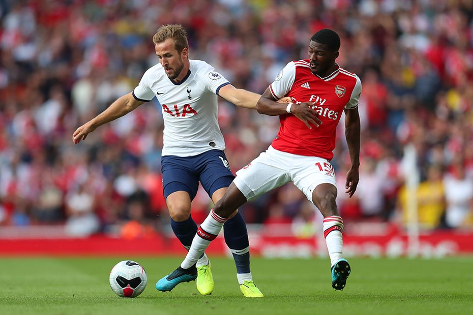 Spurs' Harry Kane in action against Arsenal's Ainsley Maitland-Niles
