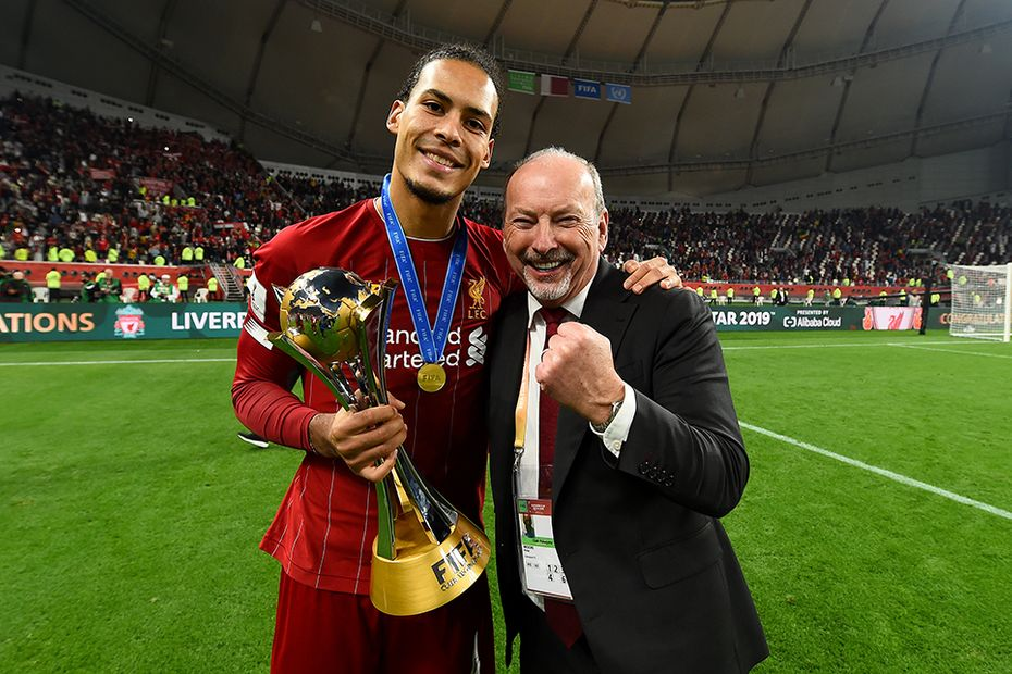 Virgil van Dijk celebrates winning the FIFA Club World Cup with Peter Moore