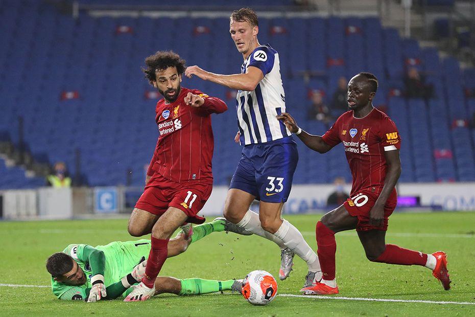 Mohamed Salah against Brighton's Dan Burn