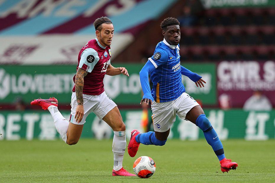 Brighton's Yves Bissouma (right) takes on Burnley's Josh Brownhill (left)