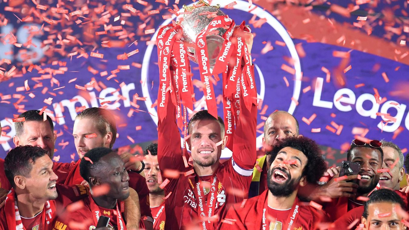 Jordan Henderson lifts the Premier League Trophy as Liverpool become seventh club to win the competition