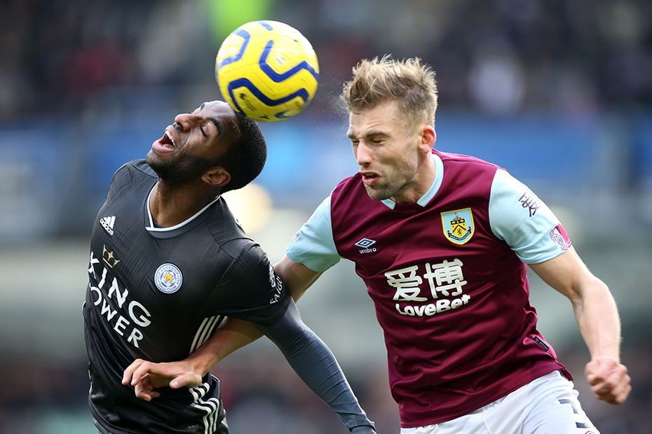 Charlie Taylor of Burnley competes against Leicester's Ricardo Pereira