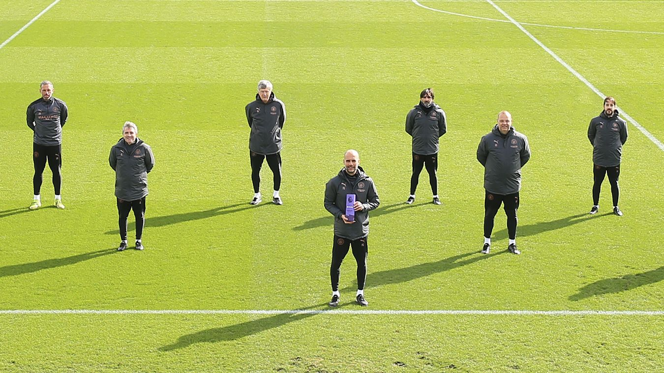 Pep Guardiola receives the Barclays Manager of the Month award alongside his coaching staff