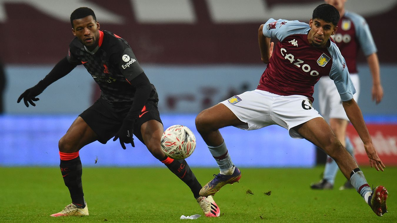 Liverpool's Georginio Wijnaldum competes with Aston Villa's Arjan Raikhy