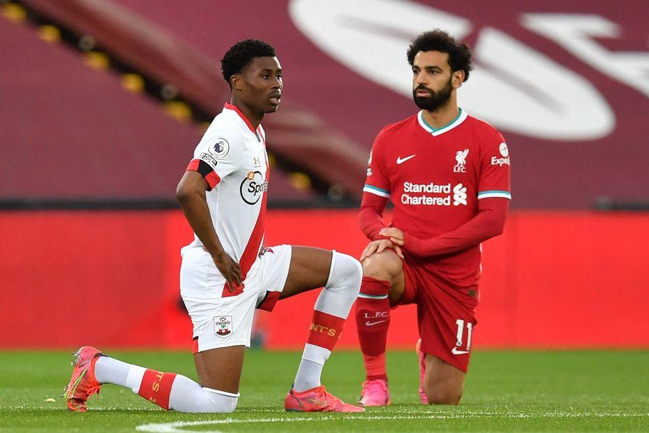 Mohamed Salah takes the knee
