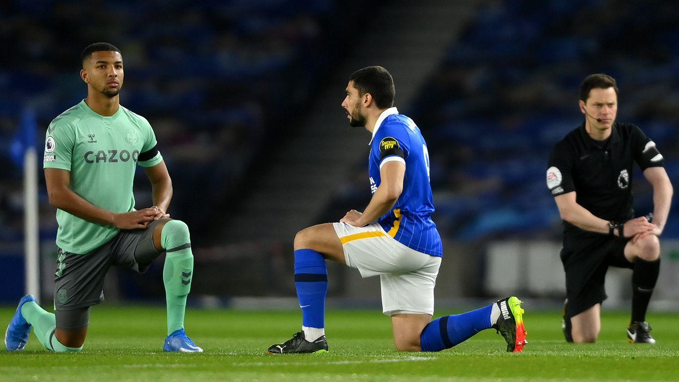 Premier League players take the knee