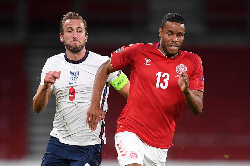 Mathias Jorgensen in action for Denmark against England's Harry Kane