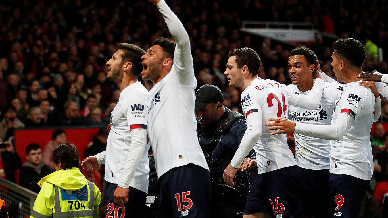 Adam Lallana celebrates with his team-mates after equalising at Old Trafford