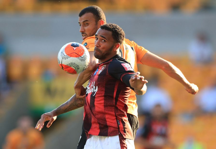 Callum Wilson and Romain Saiss