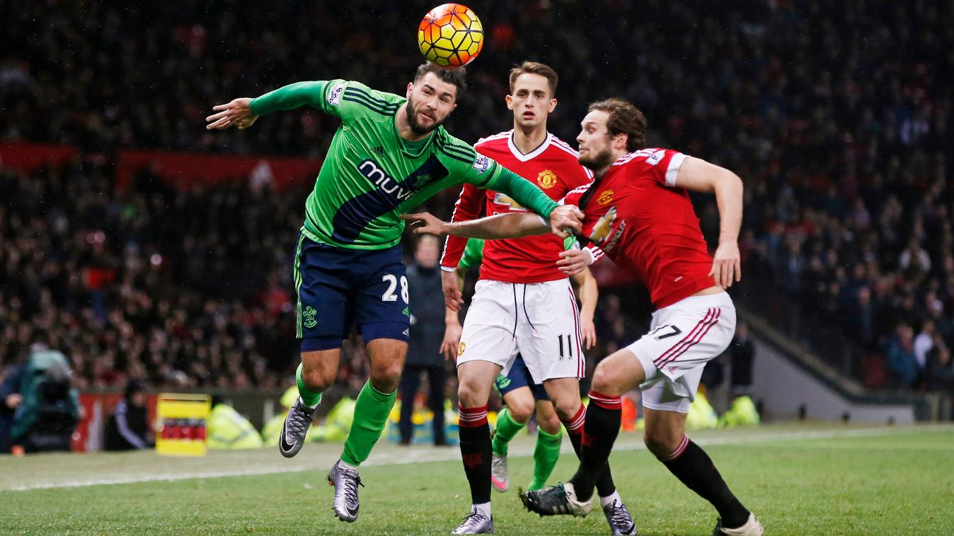 Saints striker Charlie Austin takes on Man Utd's Daley Blind