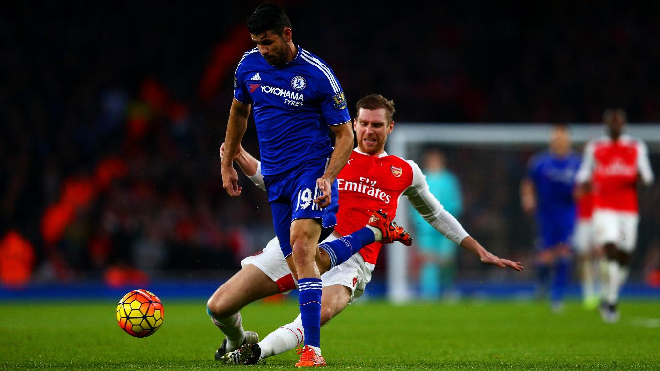 Per Mertesacker of Arsenal tackles Chelsea striker Diego Costa