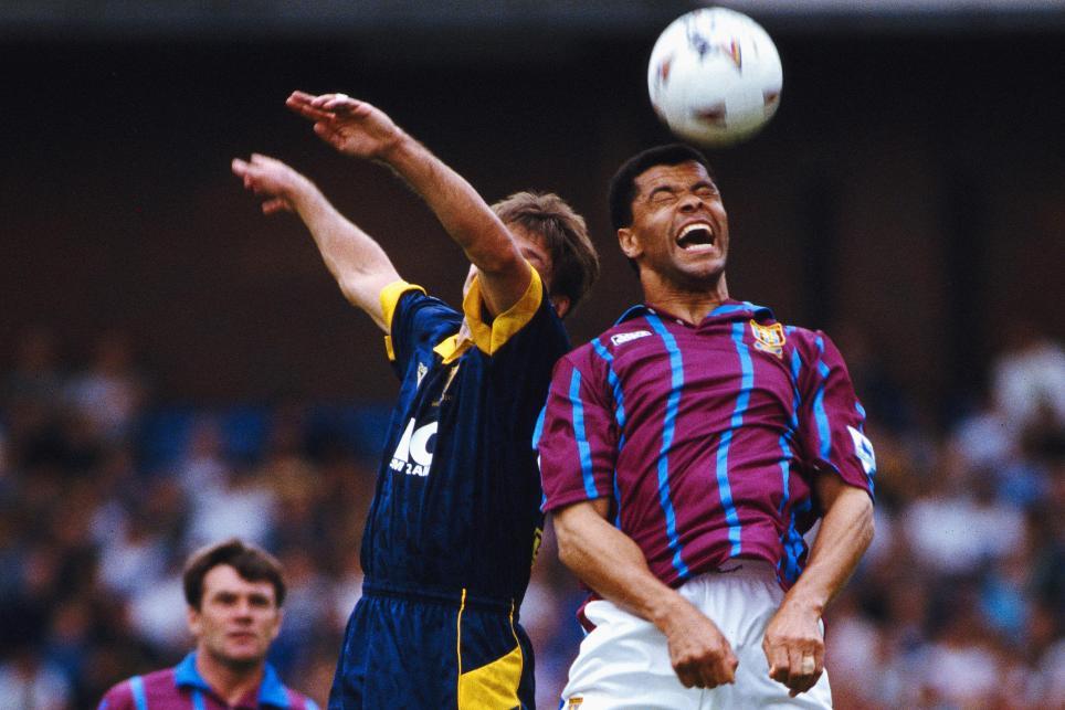Paul McGrath wins a header for Aston Villa