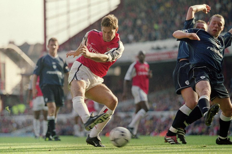Tony Adams has a shot on goal against Bolton