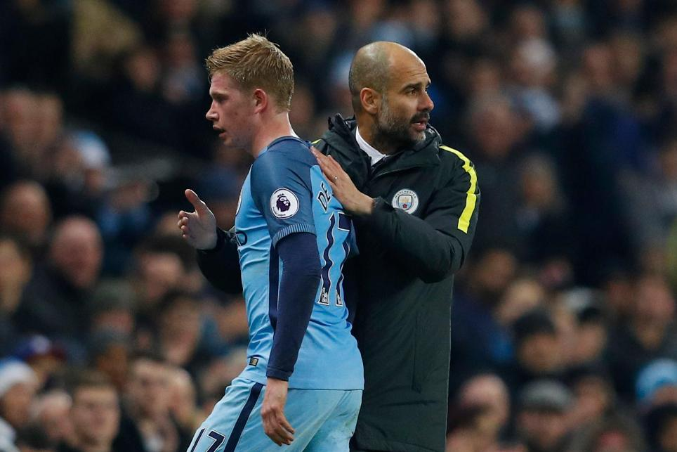 Manchester City's Kevin De Bruyne with manager Pep Guardiola as he is substituted