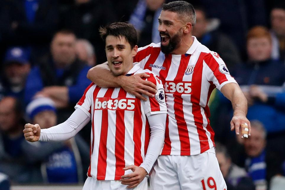Stoke City's Bojan Krkic celebrates scoring their first goal with Jonathan Walters