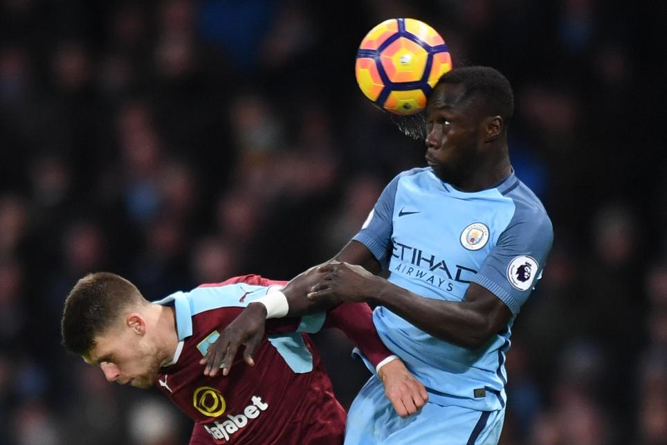 Burnley's Johann Berg Gudmundsson in action with Manchester City's Bacary Sagna