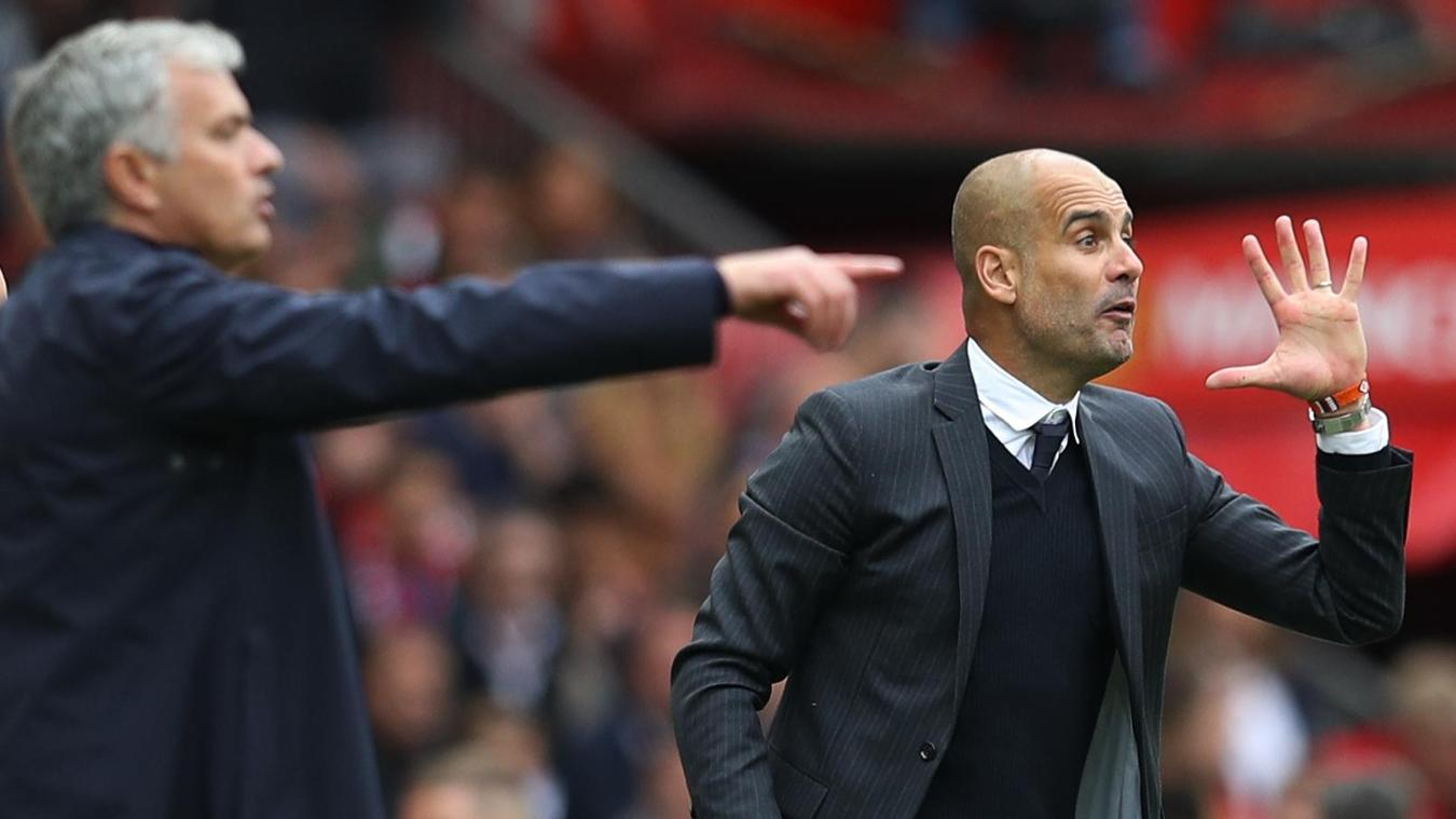 Manchester City's Pep Guardiola and Jose Mourinho of Manchester United