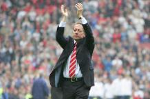 Alan Curbishley applauds the Charlton fans