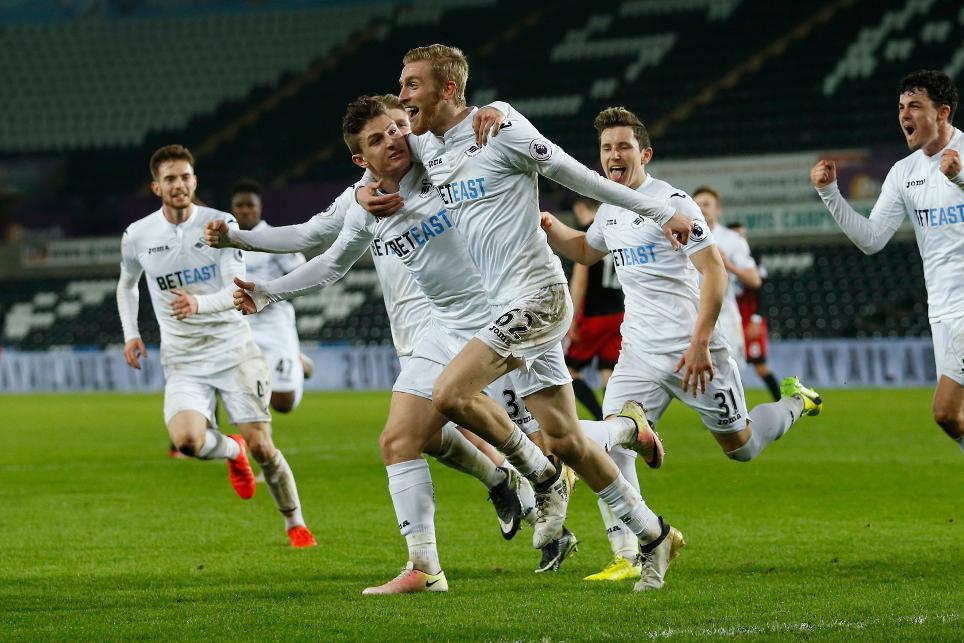 Oli McBurnie celebrates scoring for Swansea City