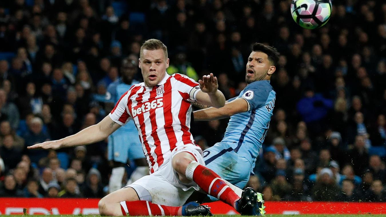 Manchester City's Sergio Aguero in action with Stoke City's Ryan Shawcross