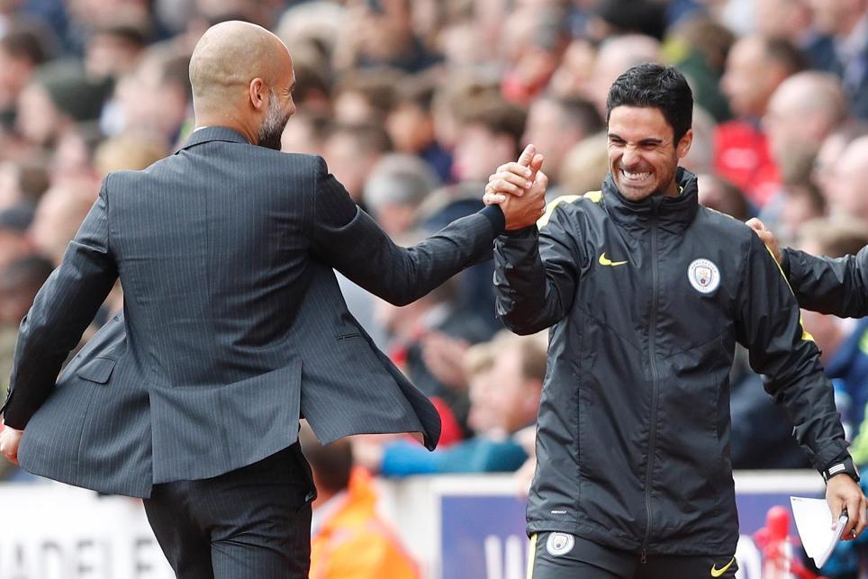 Pep Guardiola and Mikel Arteta, Manchester City
