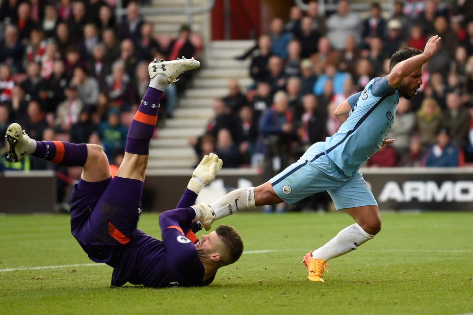 Manchester City's Sergio Aguero in action with Southampton's Fraser Forster
