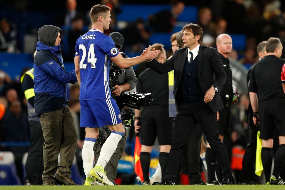 Chelsea manager Antonio Conte celebrates after the match with Gary Cahill