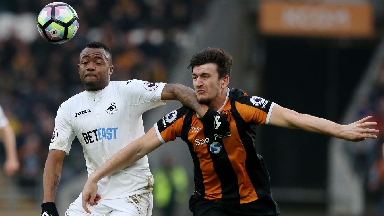Hull City's Harry Maguire and Swansea City's Jordan Ayew