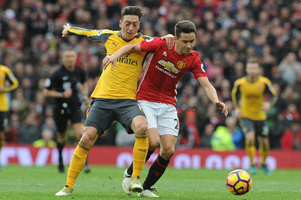 Ander Herrera and Mesut Ozil of Manchester United and Arsenal