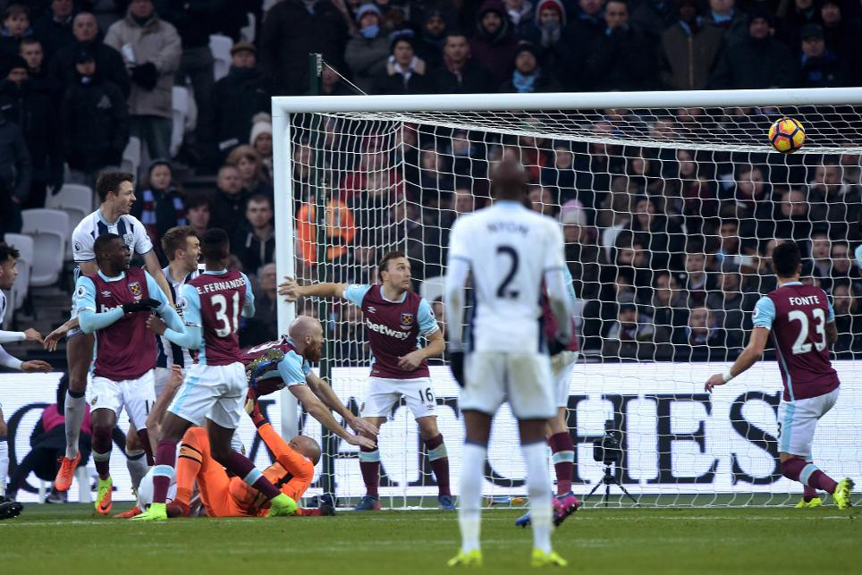 Jonny Evans and Gareth McAuley go for goal