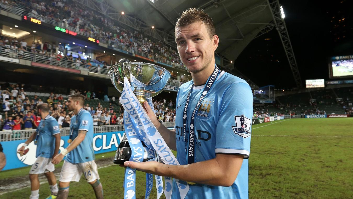 Edin Dzeko with the 2013 Asia Trophy