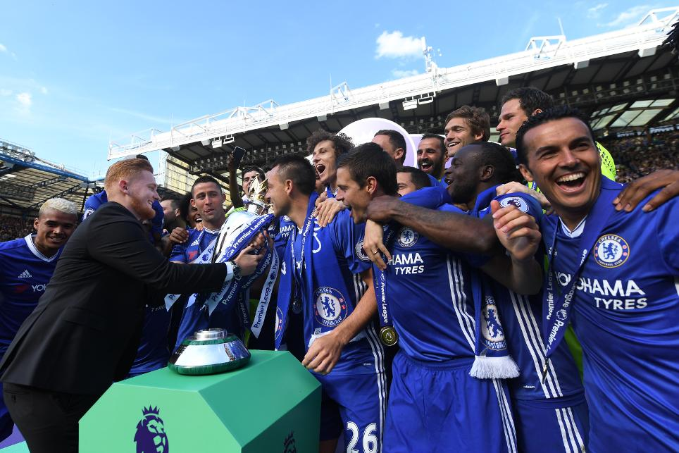 Tom Horrigan hands John Terry the Premier League Trophy